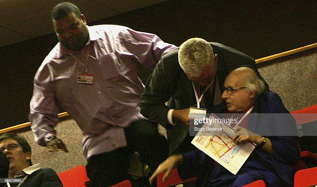 Security remove 82-year-old Walter Wolfgang (R) after he heckled Britain's Foreign Secretary Jack Straw as Straw delivered his key note speech during the annual Labour Party Conference on September 28, 2005 in Brighton, England. The governing Labour Party will be holding its yearly conference at the English coastal resort until 29 September, 2005. (Photo by Scott Barbour/Getty