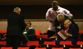 Security remove two hecklers as Britain's Foreign Secretary Jack Straw delivers his key note speech during the annual Labour Party Conference on...