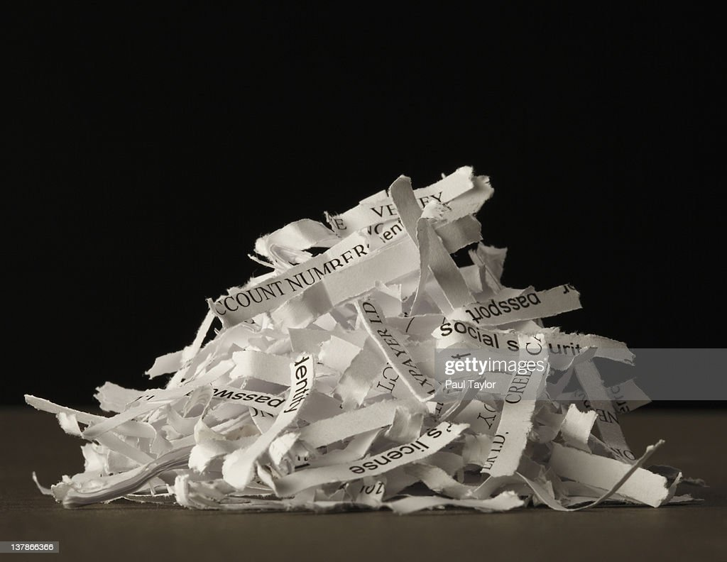 Security Risk: Piled Paper Shreds & Visible Words : Stock Photo
