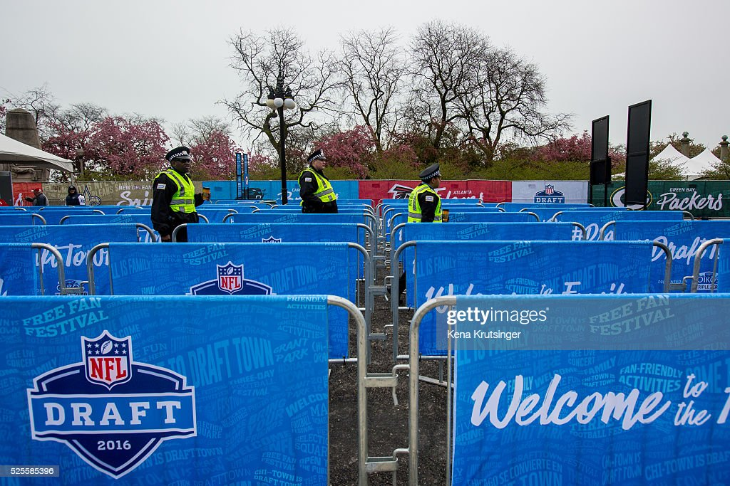 Security scans the gates before the opening of NFL Draft Town prior to the start of the 2016 NFL Draft on April 28, 2016 in Chicago, Illinois.