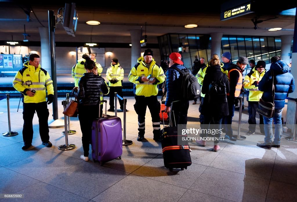 CORRECTION Security staff check passenger ID's at Kastrup airport's train station outside Copenhagen on January 4 2016 For the first time in half a...