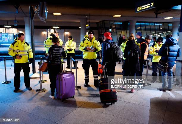 Security staff check passenger ID's at Kastrup airport's train station outside Copenhagen on January 4 2016 For the first time in half a century...