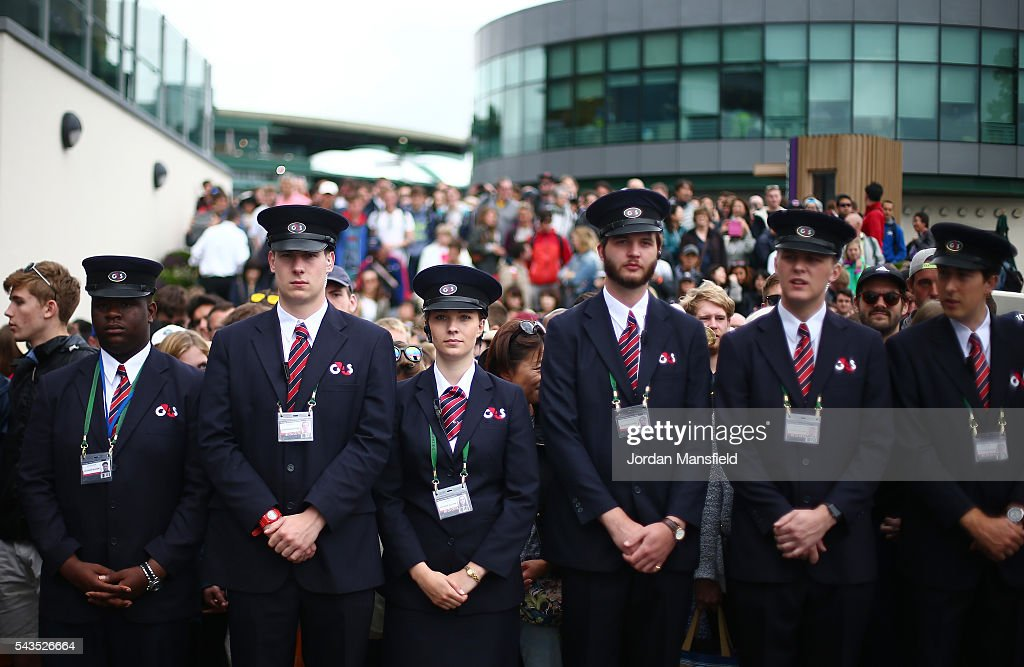 Security staff hold back the supporters prior to day three of the Wimbledon Lawn Tennis Championships at the All England Lawn Tennis and Croquet Club on June 29, 2016 in London, England.