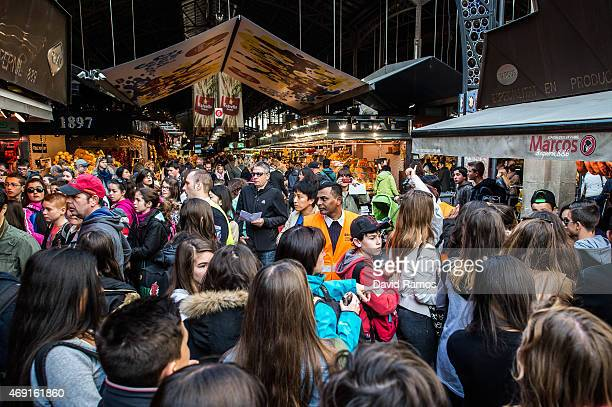 A security staff member controls access to 'La Boqueria' green market on April 10 2015 in Barcelona Spain Barcelona's city hall has put in place new...