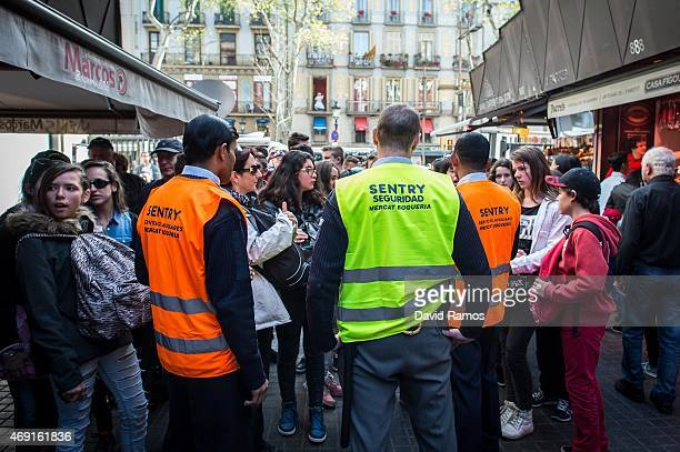 Security staff members control access to 'La Boqueria' green market on April 10 2015 in Barcelona Spain Barcelona's city hall has put in place new...
