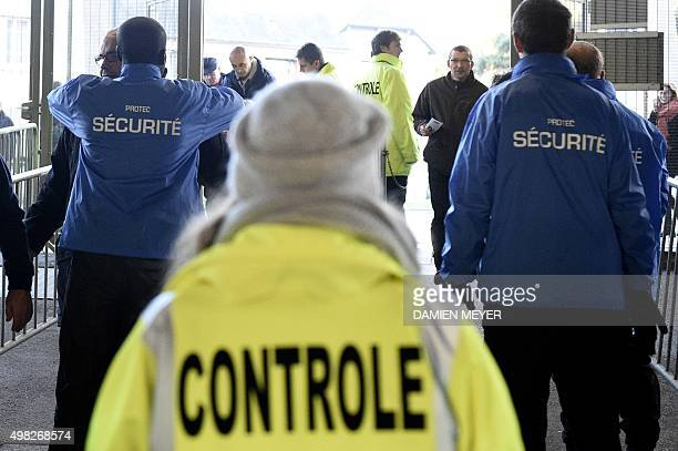 Security staff search supporters arriving at the Roazhon Park stadium in Rennes western France before the French L1 football match Rennes against...