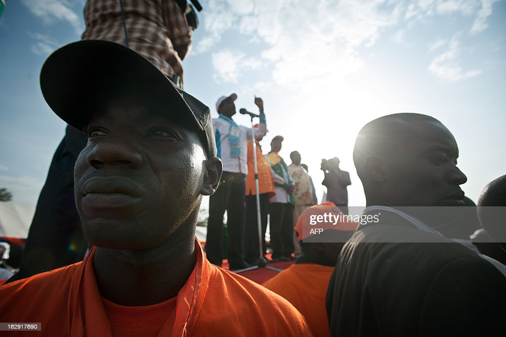 Security staff stand near the stage during a major rally of Kenya Prime minister and candidate in Kisumu town on March, 2013. Kisumu town is the home of Kenyan Prime Minister Raila Odinga, and a hotbed of support for ODM and CORD. Kenya is to hold general elections on March 4. AFP PHOTO/Will Boase