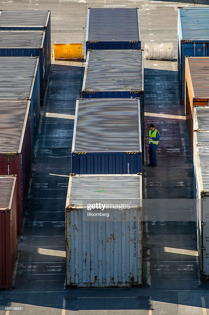 A security staff worker checks a shipping container on the quayside at the commercial port in Barcelona, Spain, on Wednesday, Jan. 29, 2014. Government bonds in Europe's most-indebted countries rallied in the first three weeks of the year on signs the debt crisis that pushed those nations' borrowing costs to euro-era records had abated. Photographer: David Ramos/Bloomberg via Getty Images
