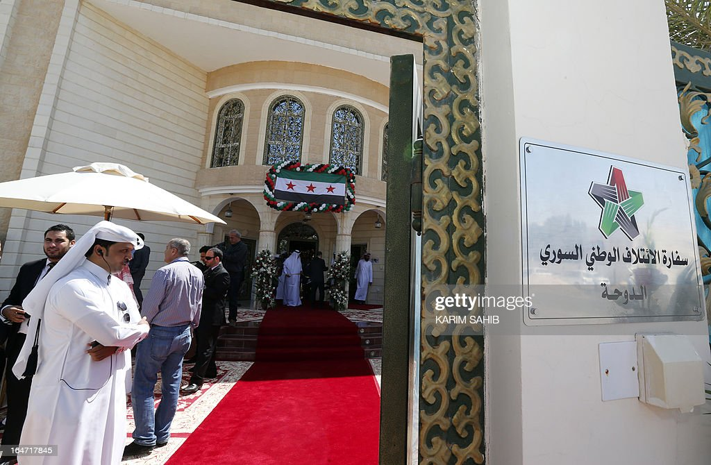 Security stands guard during the inauguration of the first embassy of the Syrian interim government to open in Qatar, in the capital Doha on March 27, 2013.