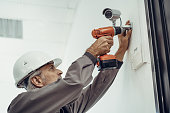 Electrician installing security system