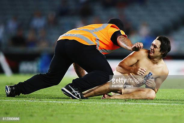 Security tackle a streaker during the round one Super Rugby match between the Blues and the Highlanders at Eden Park on February 26 2016 in Auckland...
