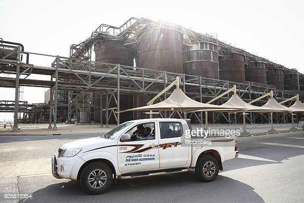 A security truck stands in front of storage tanks at the aluminium processing plant at the Ras Al Khair Industrial City operated by the Saudi Arabian...