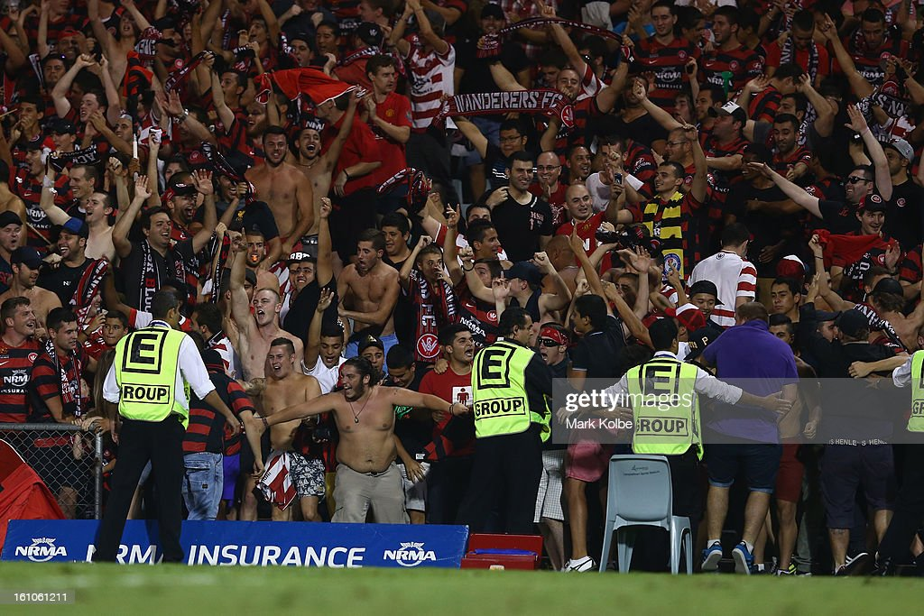 Security try to contain the crowd after the fence collasped as they celebrated with Youssouf Hersi of the Wanderers after he scored a goal during the round 20 A-League match between the Western Sydney Wanderers and the Newcastle Jets at Campbelltown Sports Stadium on February 9, 2013 in Sydney, Australia.