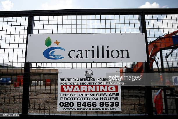 A security warning sign sits on display at the entrance gates to a construction site for new apartment blocks built by Carillion Plc in the Canning...