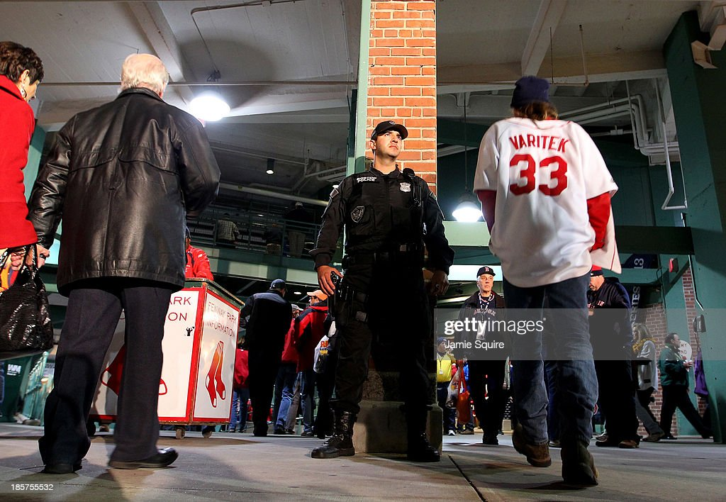 Security watches as fans enter before Game Two of the 2013 World Series between the Boston Red Sox and the St. Louis Cardinals at Fenway Park on October 24, 2013 in Boston, Massachusetts.