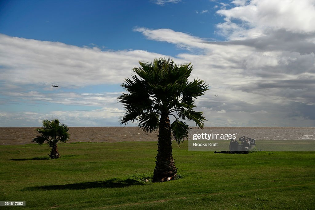 Security watches as President Bush approaches a waterside park aboard Marine One in Montevideo Uruguay Bush flew to a bilateral meeting and joint...