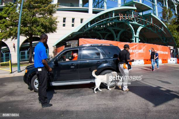 Security with bomb dogs checking every vehicle parking by Minute Maid Park prior to game two of American Division League Series between the Houston...