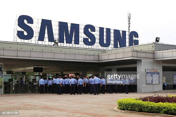 Security workers gather at the Samsung Electronics Vietnam Co Plant at Yen Phong Industrial Park in Bac Ninh Province Vietnam on Thursday Sept 1 2016...