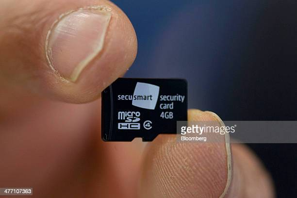 A Secusmart micro security card for mobile devices is arranged for a photograph on day three of the Mobile World Congress in Barcelona Spain on...