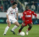 Lyon midfielder Jeremy Toulalan vies with Sedan forward Markus Mokake during their match SedanLyon during their match SedanLyon during their French...