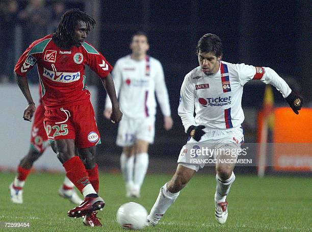 Lyon's midfielder Juninho from Brazil vies with Sedan's frenchSenegalese midfielder Aliou Cisse during their French L1 football match Sedan vs Lyon...