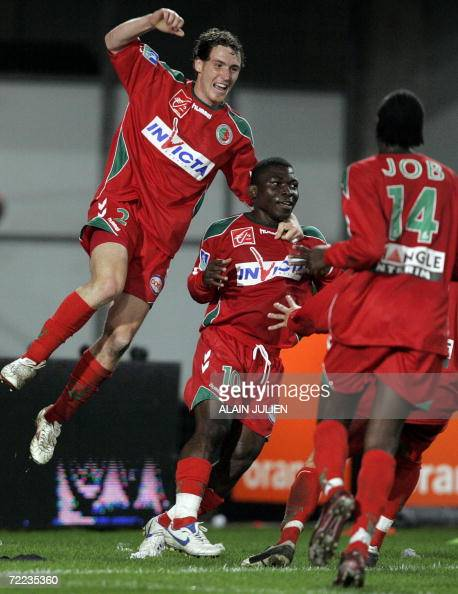Sedan's defender David Ducourtioux forwards Marcus Mokake and Desire Job jubilate during their French L1 football match 21 October 2006 at the Louis...