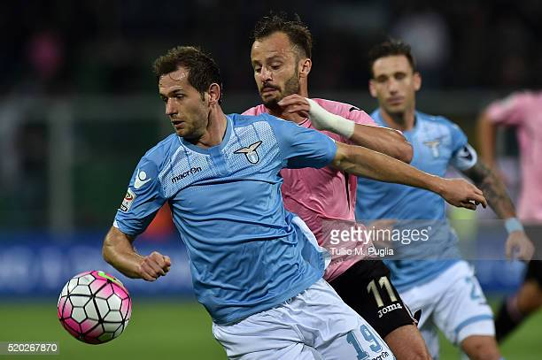 Sedan Lulic of Lazio and Alberto Gilardino of Palermo compete for the ball during the Serie A match between US Citta di Palermo and SS Lazio at...