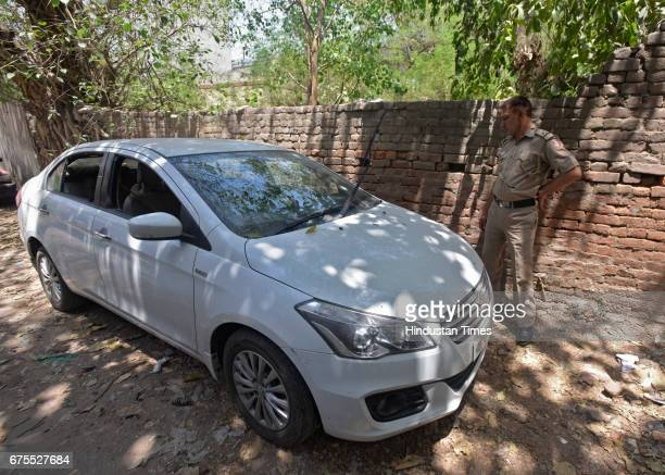 Sedan which was fired at by bikeborne assailants killing three persons including ASI at Mianwali Nagar on New Delhi India Three persons including an...