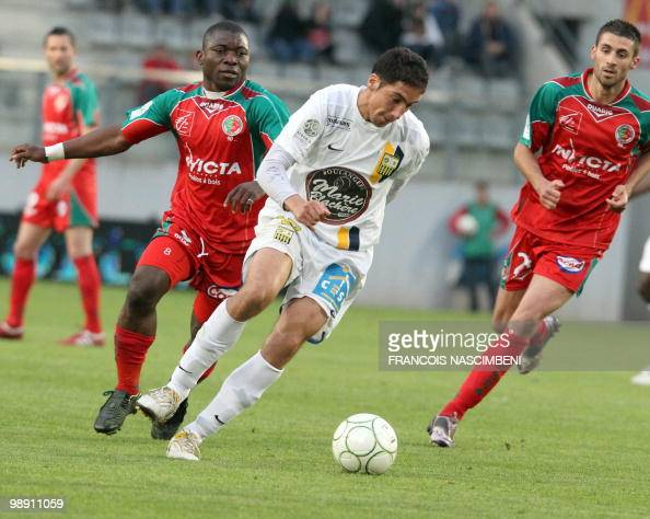 Sedan's forward Markus Mokake vies with ArlesAvignon's midfielder Thomas Ayasse during the French L2 football match Sedan vs ArlesAvignon on May 7...