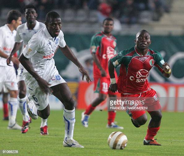 Sedan's Marcus Mokake Mwambo fights for the ball with Auxerre's Adama Coulibaly during the French League Cup football match Sedan vs Auxerre on...