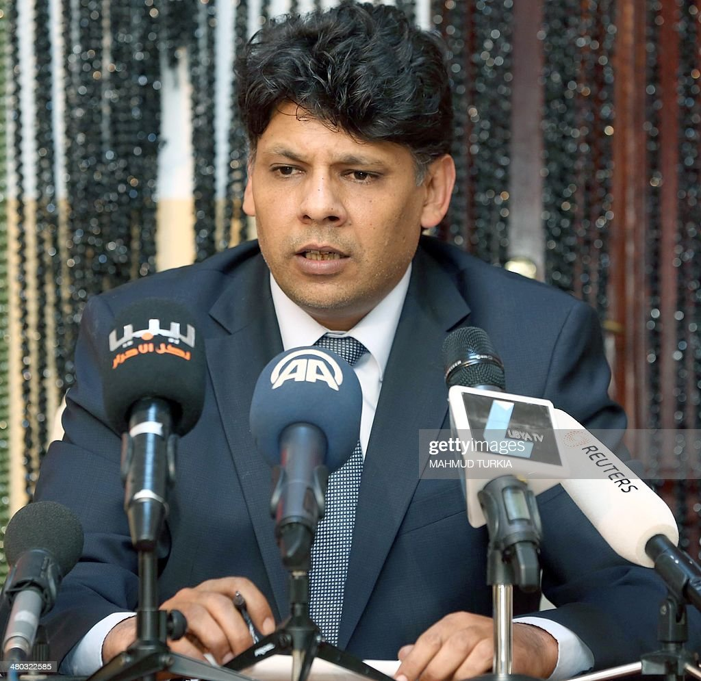 Seddik al-Sour, spokesman for the Libya state prosecutor's office, speaks during a press conference where he announced the start of the trials on April 14 of Seif al-Islam and Saadi Kadhafi, two of the sons of Libya's late dictator Moamer Kadhafi and of former spy chief Abdullah Senussi, on March 24, 2014, in the capital Tripoli. The two sons and more than 30 officials from the ousted regime are to stand trial on charges ranging from murder to embezzlement, Sour said.