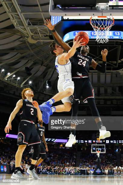 Sedee Keita of the South Carolina Gamecocks defends a shot by Grayson Allen of the Duke Blue Devils in the first half during the second round of the...
