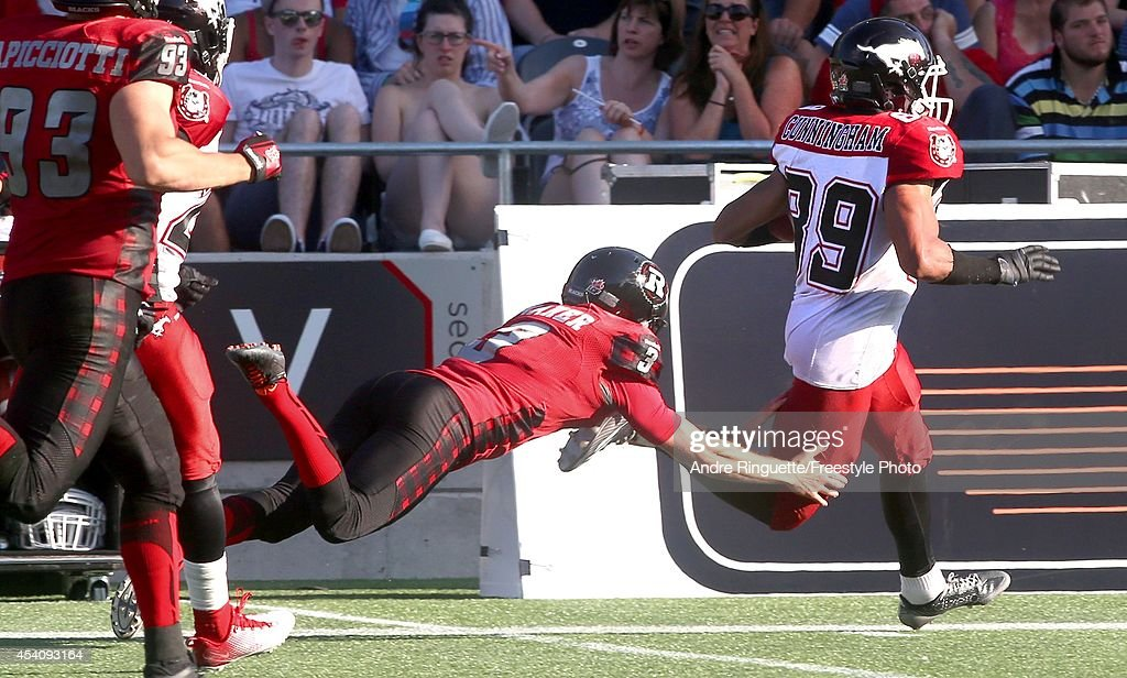 Sederrik Cunningham #89 of the Calgary Stampeders returns a punt for a touchdown as kicker Brett Maher #3 of the Ottawa Redblacks dives for the tackle during a CFL game at TD Place Stadium on August 24, 2014 in Ottawa, Ontario, Canada.