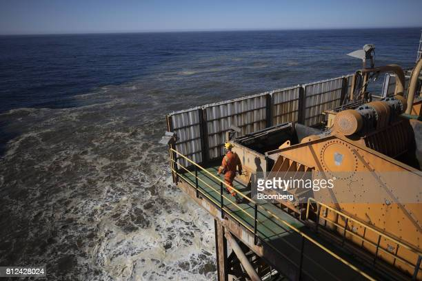Sediment clouds the water during offshore diamond mining operations aboard the Mafuta diamond mining vessel operated by Debmarine Namibia a joint...