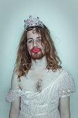 Seductive Male Prom queen in drag tiara on head lipstick