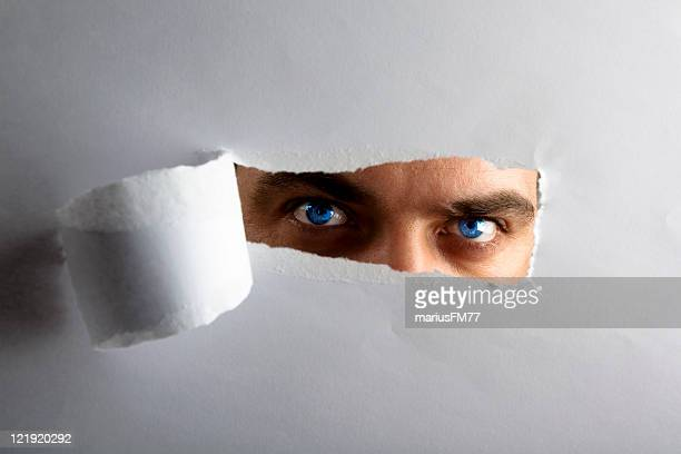 I see you! - man looking through keyhole