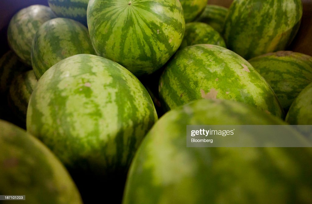 Seedless watermelons sit in crates at the Specialty Produce warehouse in San Diego, California, U.S., on Friday, Nov. 1, 2013. The U.S. Bureau of Economic Analysis is scheduled to release gross domestic product (GDP) figures on Nov. 7. Photographer: Sam Hodgson/Bloomberg via Getty Images