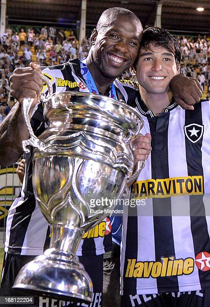 Seedorf and Nicolas Lodeiro of Botafogo pose for a photo after winning the Rio State Championship 2013 at Raulino de Oliveira Stadium on May 05 2013...