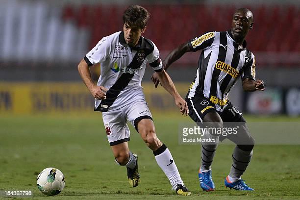 Seedorf of Botafogo and Juninho Pernambucano of Vasco struggle for the ball during a match between Botafogo and Vasco as part of the Brazilian...
