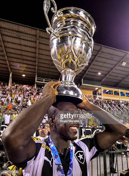 Seedorf of Botafogo celebrates after winning the Rio State Championship 2013 at Raulino de Oliveira Stadium on May 05 2013 in Volta Redonda Brazil