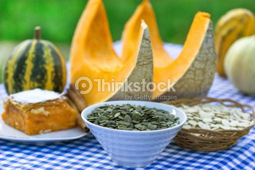Seeds, cake and slices of pumpkin : Stock Photo