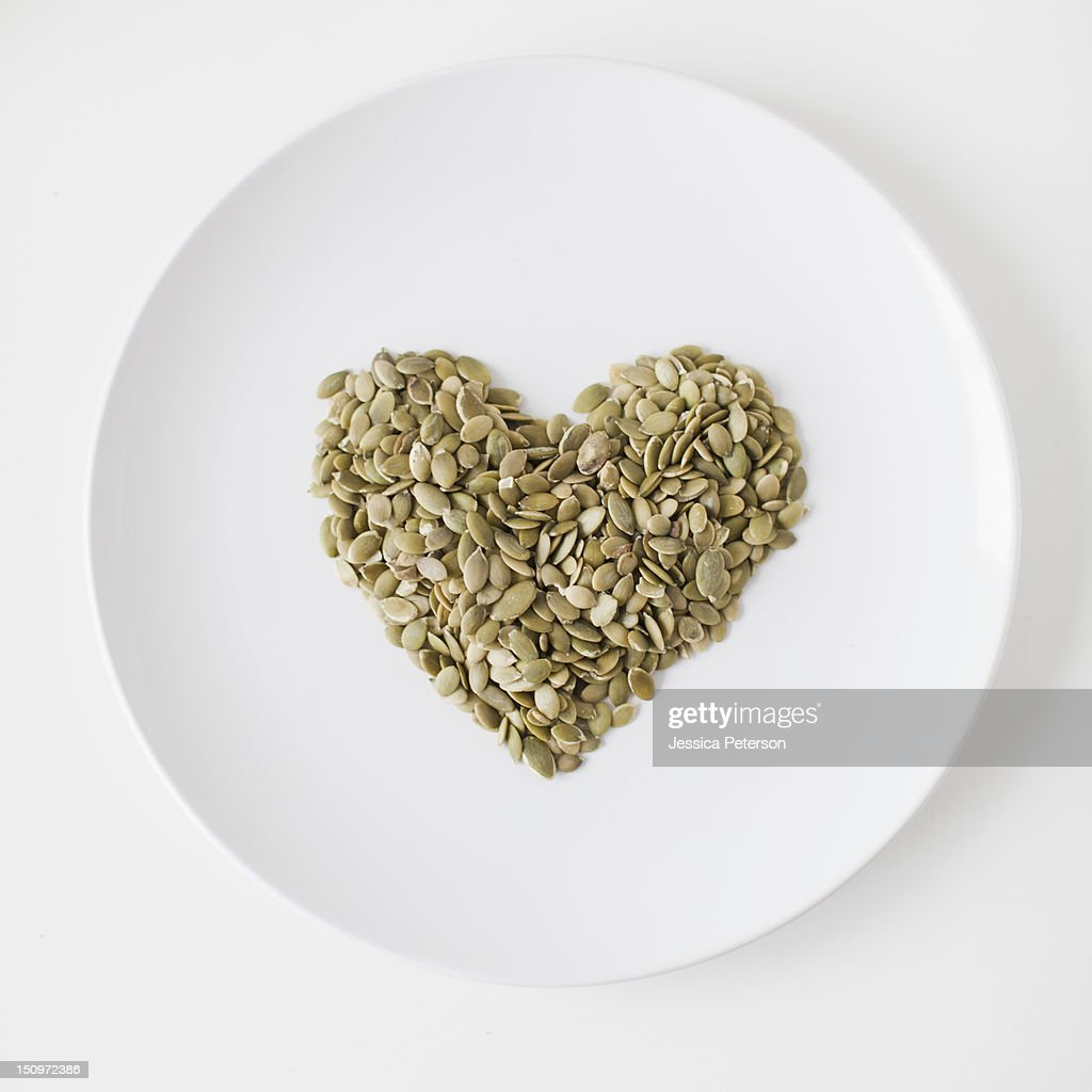 Seeds heart on plate, studio shot : Stock Photo