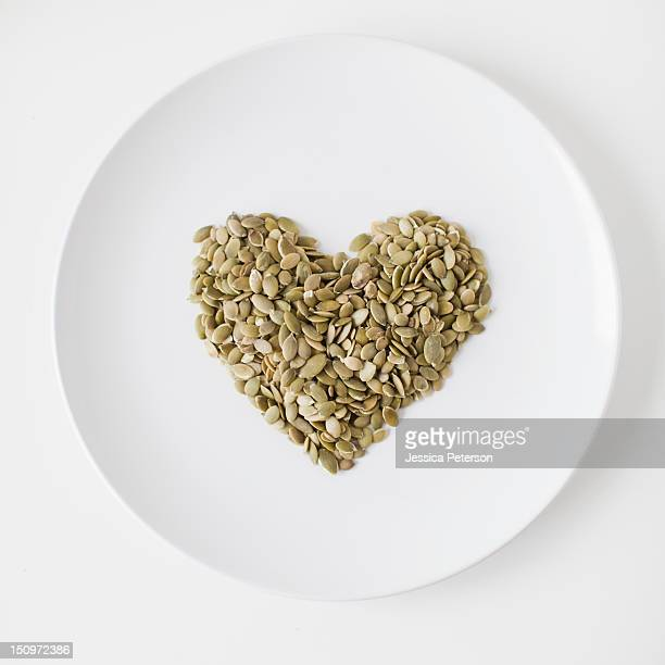 Seeds heart on plate, studio shot