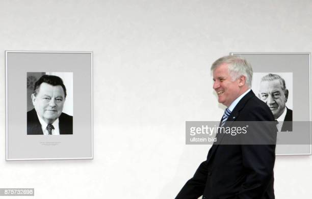 Seehofer Horst Politician Prime Minister of Bavaria CSU Germany in front of photographies from Franz Josef Strauss and Alfons Goppel