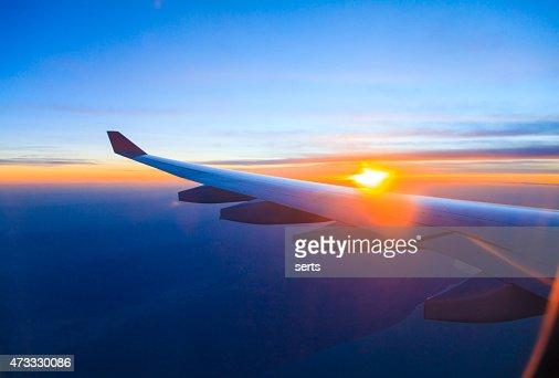 Seeing the sunset on flight