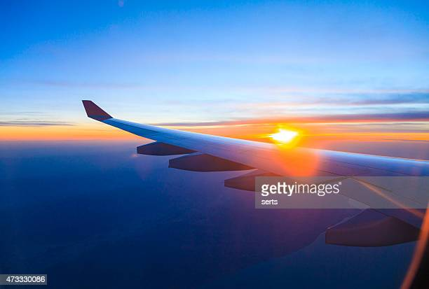 Seeing the sunset on flight
