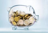 A see through piggy bank with money coinsSeeing through piggy bank with money coins