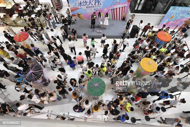Seeking relief from the summer temperatures hundreds in Taiyuan capital of north Chinas Shanxi Province take advantage of the 'Ice Beverage...