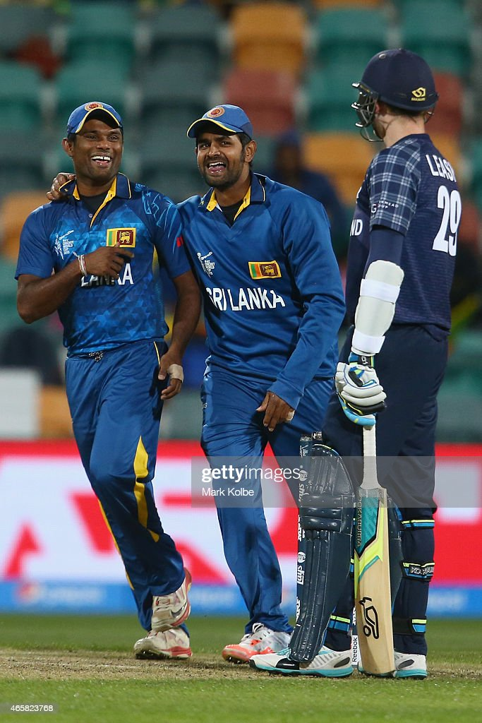 Seekkuge Prasanna and <a gi-track='captionPersonalityLinkClicked' href=/galleries/search?phrase=Lahiru+Thirimanne&family=editorial&specificpeople=5946377 ng-click='$event.stopPropagation()'>Lahiru Thirimanne</a> of Sri Lanka celebrate the wicket of Michael Leask of Scotland during the 2015 Cricket World Cup match between Sri Lanka and Scotland at Bellerive Oval on March 11, 2015 in Hobart, Australia.