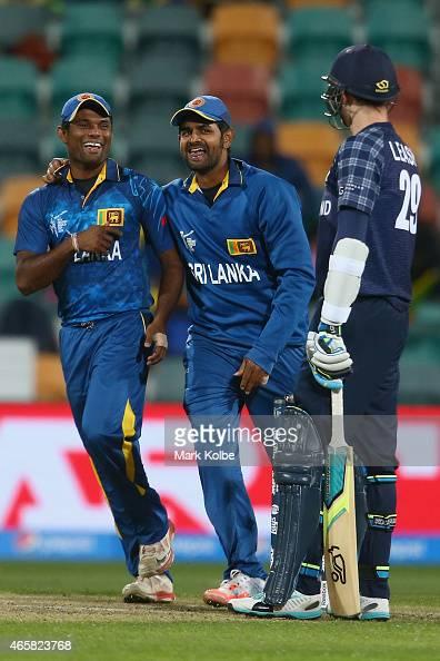 Seekkuge Prasanna and Lahiru Thirimanne of Sri Lanka celebrate the wicket of Michael Leask of Scotland during the 2015 Cricket World Cup match...